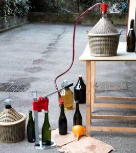 homemade wine bottling in the backyard