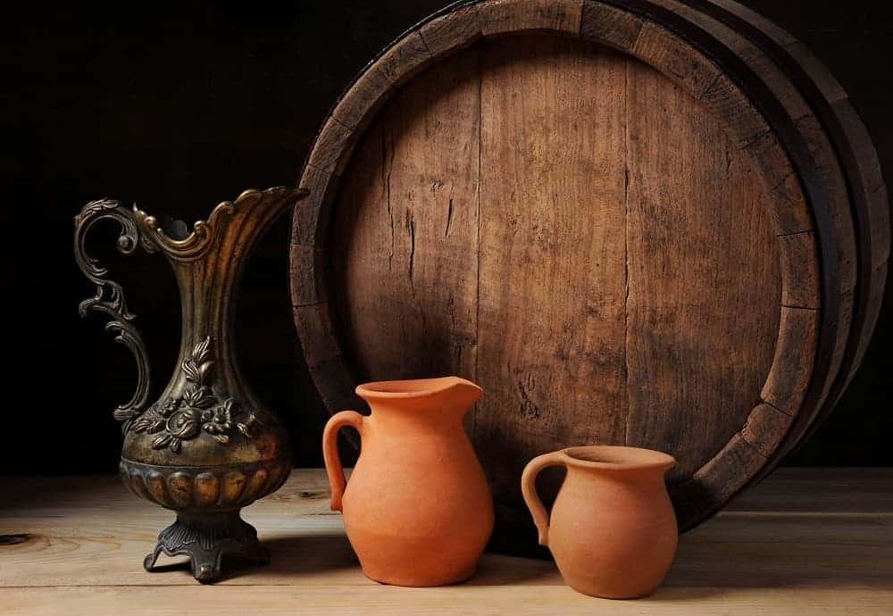 Barrel with metal jug and pots