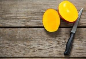 preparing a mango for wine