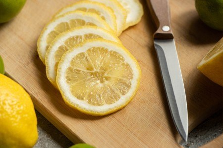 Close up view of sliced lemon on wooden cutting board