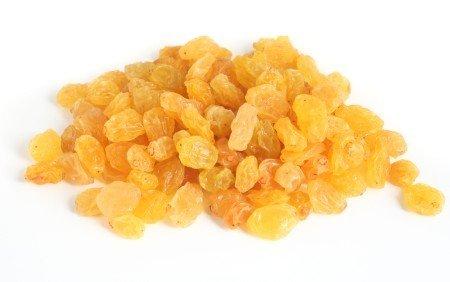 Golden raisins over white background